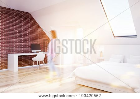 Woman in a brick attic bedroom with a home office a wooden floor a table with a computer and a white bed. Corner. 3d rendering mock up toned image