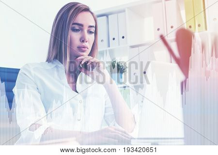 Portrait of a gorgeous businesswoman with full lips wearing a white blouse and looking at her laptop screen thinking. Toned image film effect