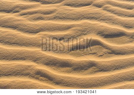 Perfect texture of sand waves. Sand waves pattern in the desert. ground wave