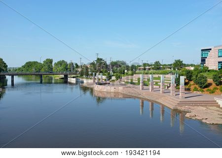 SIOUX FALLS, SOUTH DAKOTA - JUNE 21, 2017: Riverwalk park along the Big Sioux River. Parks, hotels, restaurants and footbridges, line the popular area along the cities revitalized downtown district.