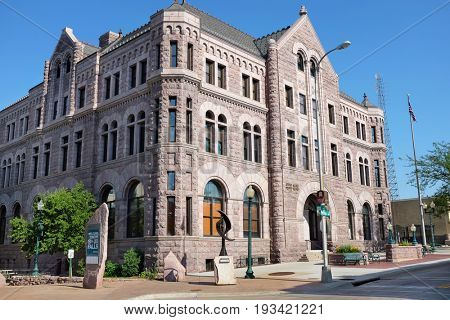 SIOUX FALLS, SOUTH DAKOTA - JUNE 21, 2017: US Courthouse Sioux Falls. The Romanesque style buildings exterior walls are primarily of rose-colored quartzite (also known as jasper).