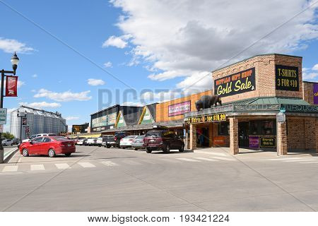 WALL, SOUTH DAKOTA - JUNE 22, 2017: Main Street with Shops. The busy tourist attraction, Wall Drug, and other shops on a typical summer day.