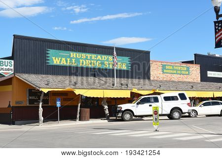 WALL, SOUTH DAKOTA - JUNE 22, 2017: Hustead's Wall Drug. The tourist attraction has grown to be a favorite stop for travelers along Interstate 90 drawing over 2 million visitors a year.