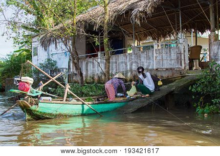 Vietnamese Woman Trade Fruit And Vegetables From A Wood Boat