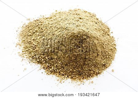 Brown pile of powder isolated on a white background. Milled boletus edulis mushrooms.