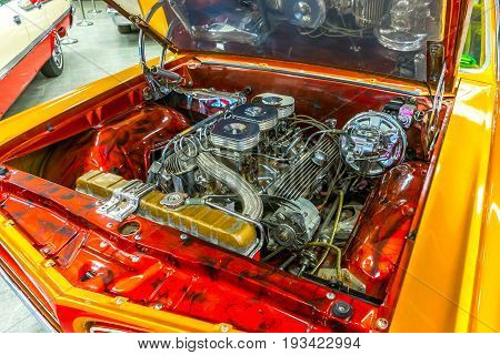 The engine of the classic American car. Outdoor car hood