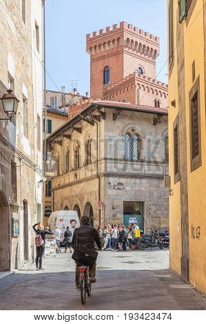 Pisa, Italy - April 07, 2017: A street with a bicyclist in Pisa, Tuscany