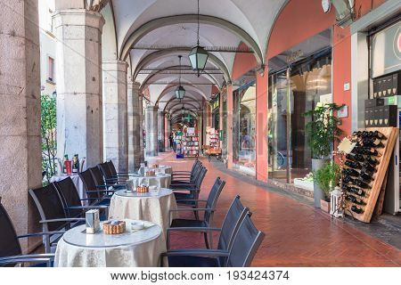 Pisa, Italy - April 07, 2017: An open cafe in the gallery on street of Pisa