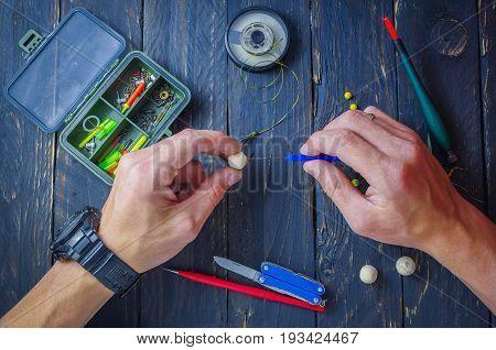 A man is drilling a carp boil. Sport fishing. Carp fishing.