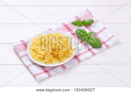 plate of quadretti - square shaped pasta on checkered dishtowel