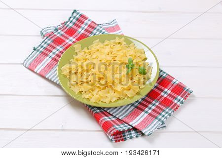 plate of quadretti - square shaped pasta on checkered place mat