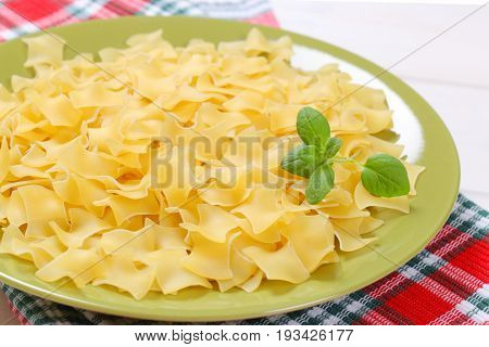 plate of quadretti - square shaped pasta on checkered place mat - close up