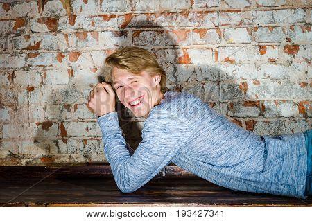 Young caucasian attractive guy posing in studio