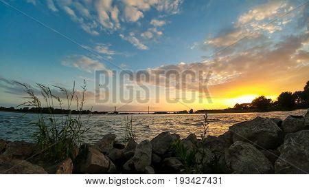 sundown at the rhine bridge Rees Germany wide angle
