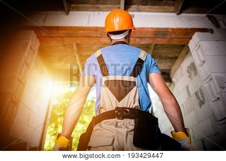 Pro Builder Ready For Work. Building a New House Concept Photo. Caucasian Construction Worker in Orange Hard Hat.