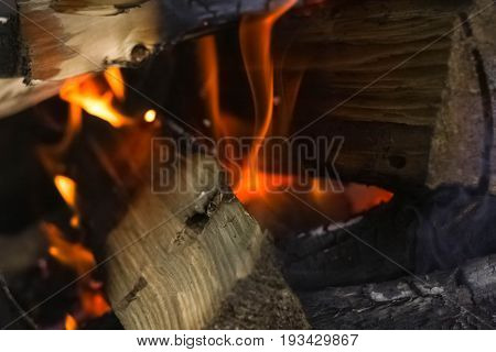 in the oven ignite dry wood orange fire