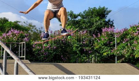closeup of one skateboarder practice skateboarding outdoor