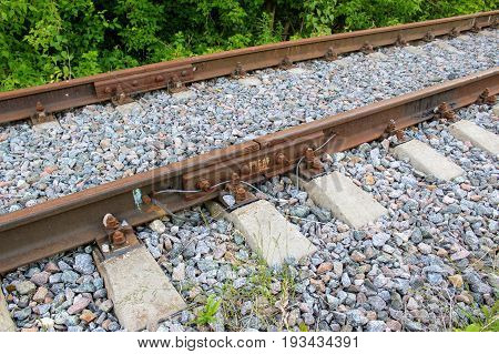 Rusty track rails. The railway track itself is new, the rails rust from time because there are no trains running through them.
