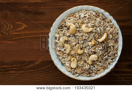 Muesli With Nuts Cashews . Muesli On A Wooden Table. Muesli Top View . Healthy Food
