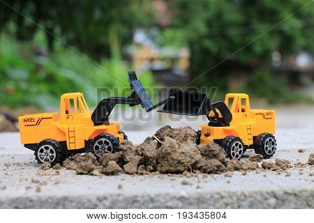 Truck Toy Car With Sand And Soil On The Concrete Floor With Blur Boken Green Environment  Constructi