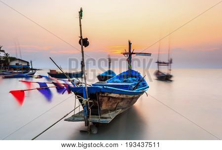 Old fishing boats at sea with sunset