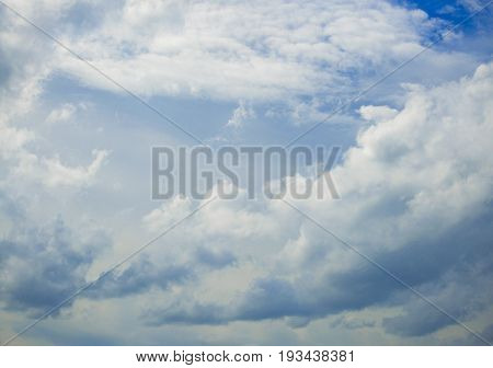 The white clouds and blue sky in the daytime.