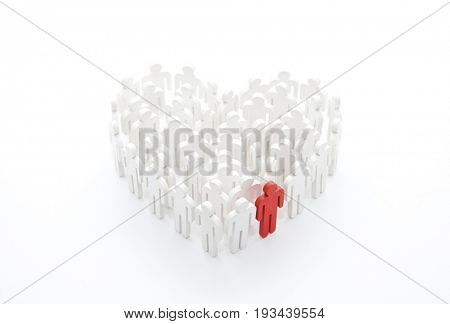 Group of people in the shape of a heart with one red person