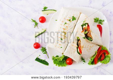 Burritos Wraps With Minced Beef And Vegetables On A Light Background. Flat Lay. Top View
