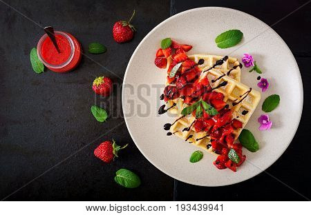 Belgium Wafers With Strawberries, Chocolate And Syrup On A Plate. Flat Lay. Top View.