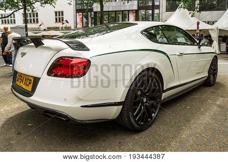 BERLIN - JUNE 17 2017: Personal luxury car Bentley Continental GT 2017. Rear view. Classic Days Berlin 2017.