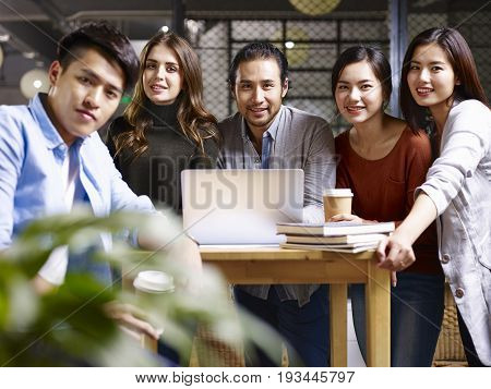 a team of multinational business people looking at camera smiling.