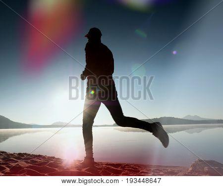 Leakage Of Light In The Lens. Running Man. Sportsman Run, Jogging Guy During The Sunrise Above Sandy