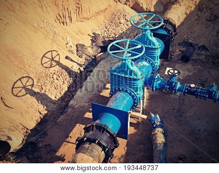 Gate Valves Underground, Water Pipeline Valve On A Blue Pipeline After Reconstruction.