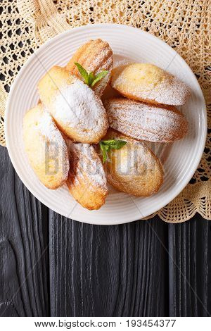 French Biscuit Madeleine Close-up On A Plate On The Table. Vertical Top View