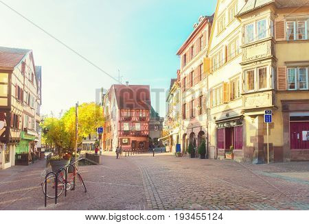 street of Colmar, most famous town of Alsace, France, retro toned
