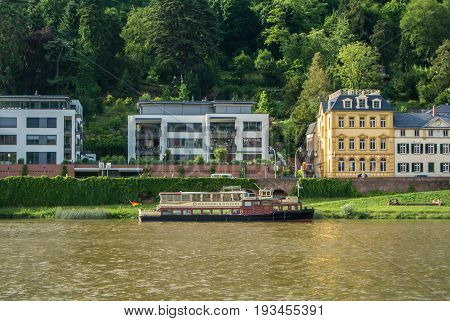 Heidelberg, Germany - June 4, 2017: An Ambankment Of A Neckar River With Colorful Houses And A Ship