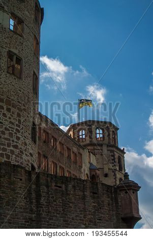 A Tower Of Heidelberg Castle With A Flag Over The Hill, Baden-württemberg, Germany.