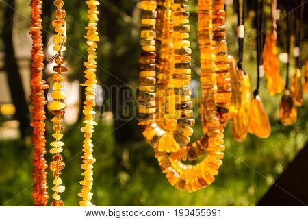 Amber pendants and necklaces at the street market of Curonian Spit Kaliningrad region Russia.