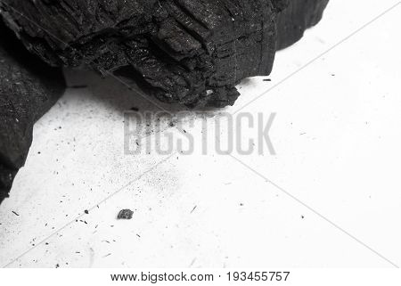 Black Abstract Textured Composition On A White Background, A Selected Focus Close-up Of A Pile Of Cu