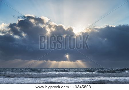 Stuning Cloud Formations Over Sea At Sunset With Precuspular Sun Beams Through Clouds