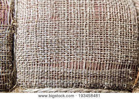 Tattered Sackcloth Background. Old Burlap With Hole.