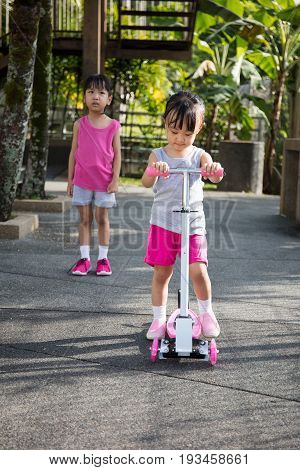 Asian Little Chinese Girls Arguing To Play The Scooter