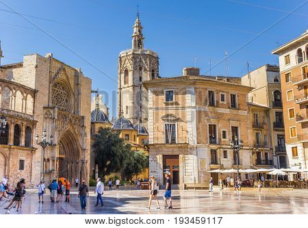 VALENCIA, SPAIN - JUNE 12, 2017: People at the cathedral on the Plaza de la Virgen in Valencia, Spain