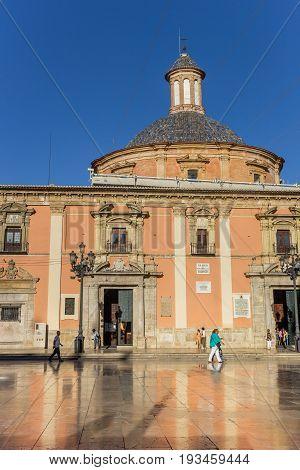 VALENCIA, SPAIN - JUNE 12, 2017: Basilica de la Virgen with reflection in the marble tiles in Valencia, Spain