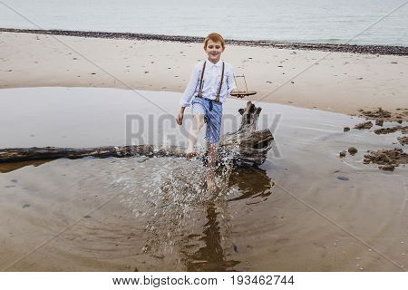 the boy is given a boat at sea