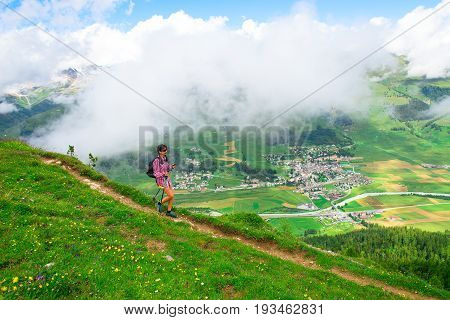 Girl during an excursion in Engadin valley above Zuoz village.