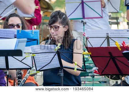 Young Girl In Glasses Play On Oboe At Street Orchestra In Annecy.  France