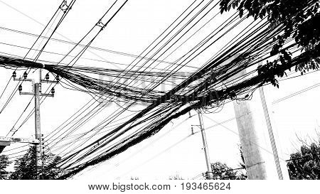 Electricity and communication line posterized image black and white Has bunting sky train green line Phaholyothin Road in Bangkok Thailand.