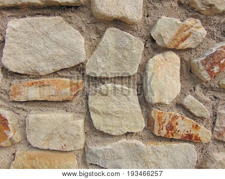 natural stone wall outdoors usable as background