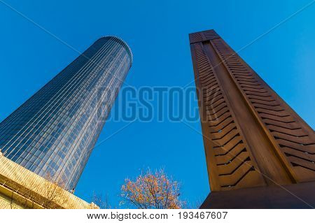 Bottom view of the skyscraper and the Andrew Young Obelisk on the background of clear sky Atlanta USA